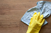 istock Employee hand in rubber protective glove with microfiber rag wiping blue table, wall or floor surface in room, bathroom, kitchen. Early spring or regular cleanup. Commercial cleaning company concept 1163536848