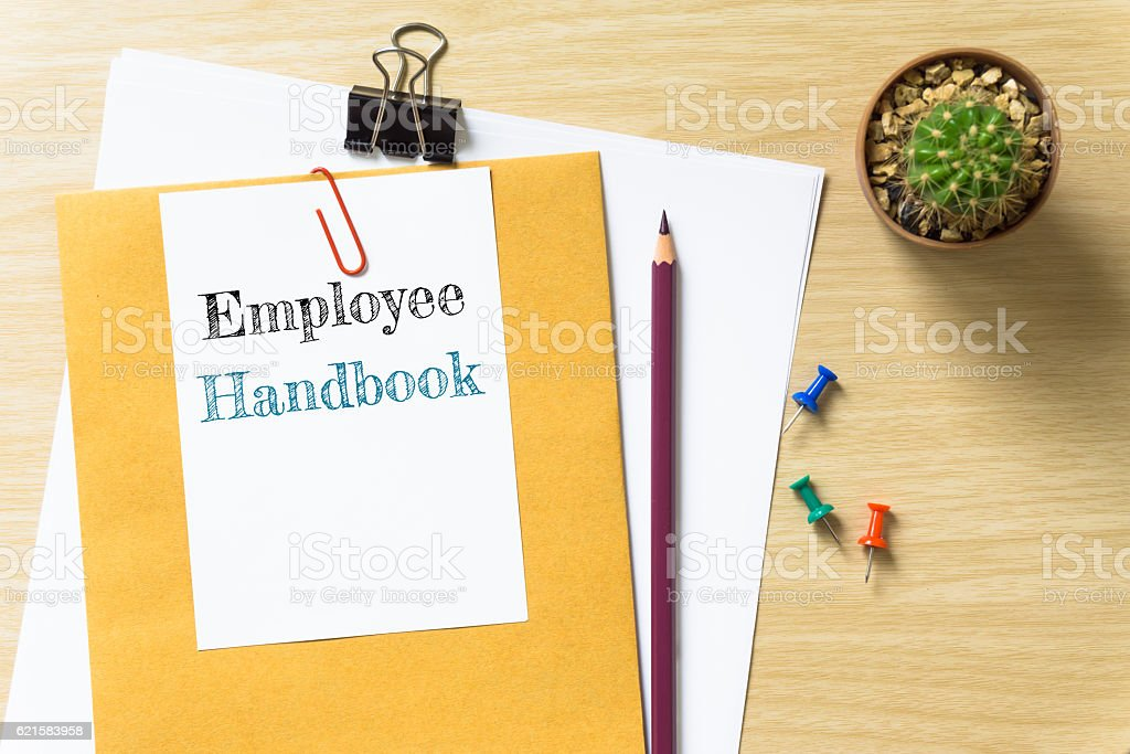 Employee Handbook, message on the white paper. stock photo