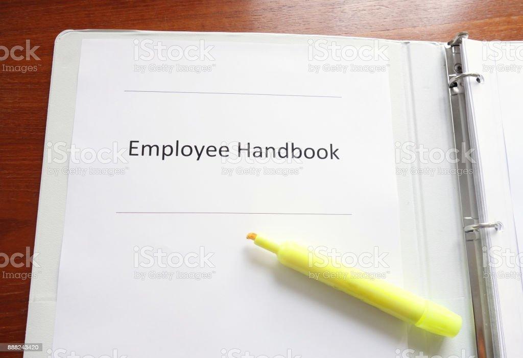 Employee Handbook on a desk stock photo