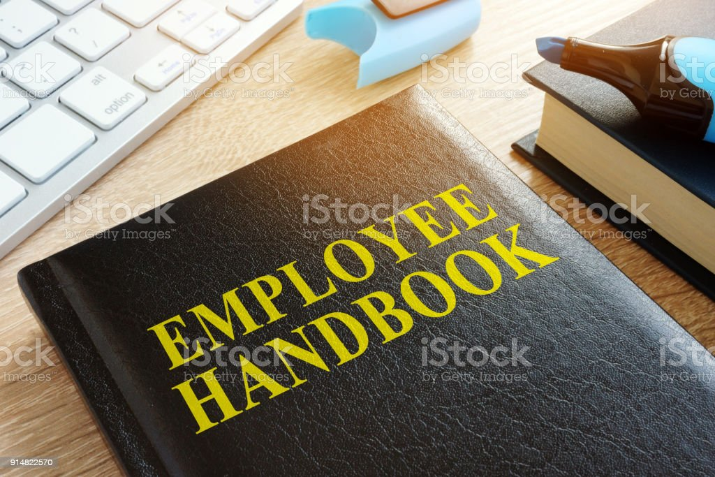 Employee handbook on a wooden desk. royalty-free stock photo