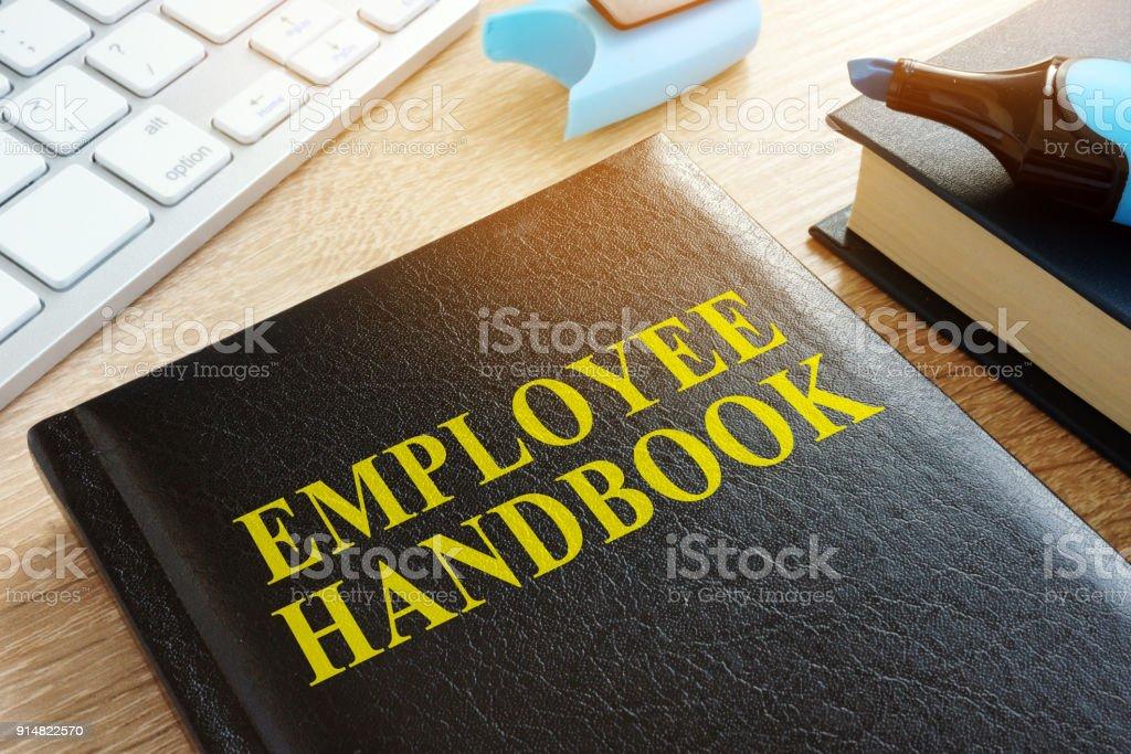 Employee handbook on a wooden desk. stock photo