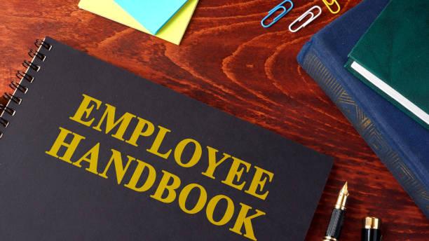 Employee Handbook or manual in an office. stock photo