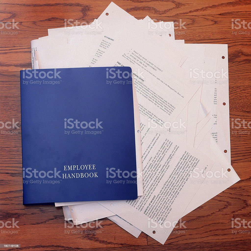 Employee Handbook Stuffed With Paperwork stock photo