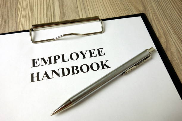 Employee handbook with pen on desk stock photo