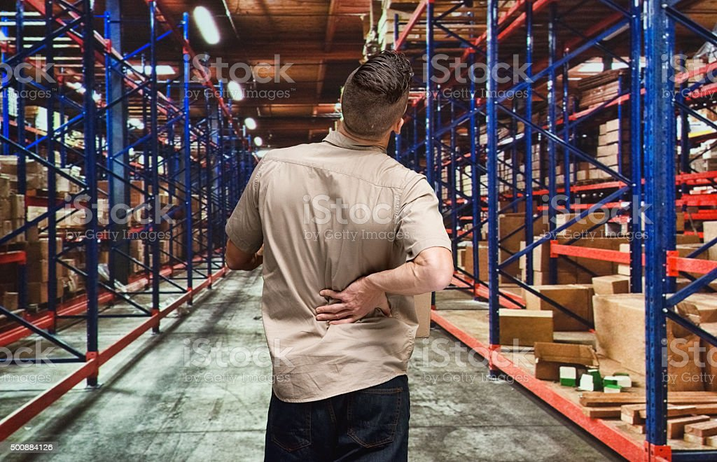 Employee having back pain stock photo
