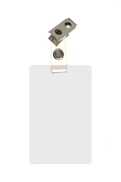 employee identification badge on white background - kimlik stok fotoğraflar ve resimler