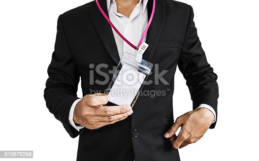 Employee in black suit showing ID card, isolated on white background