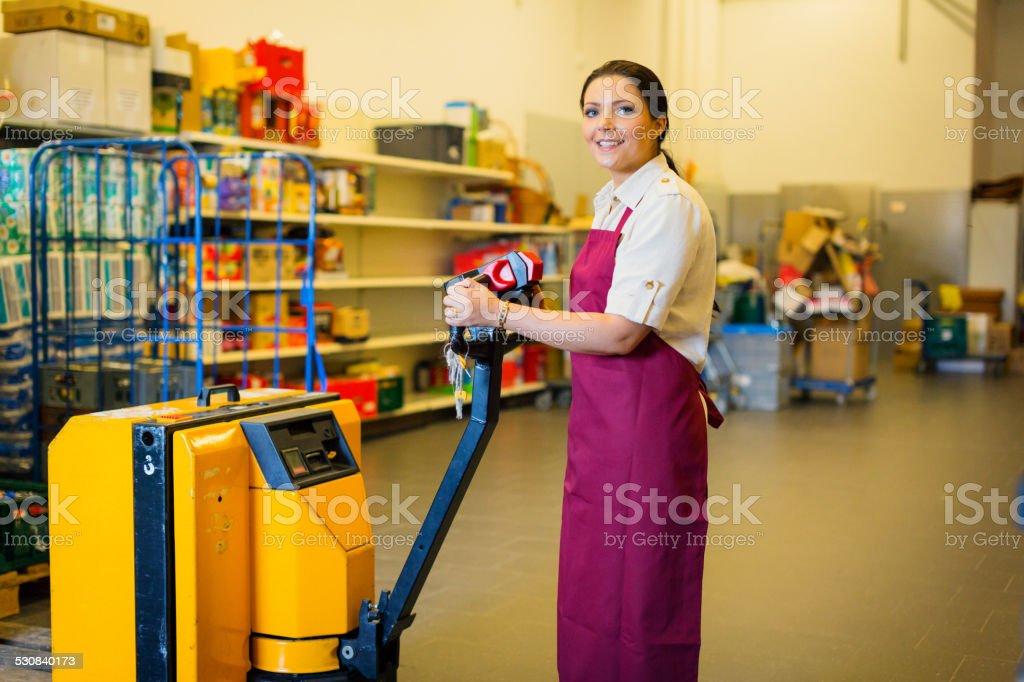 employee in supermarket warehouse stock photo
