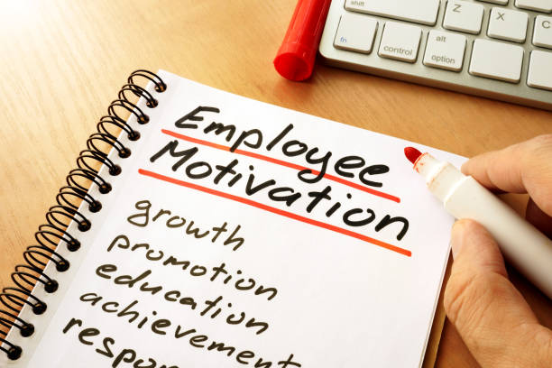 employee motivation written in a note. - employee engagement stock photos and pictures