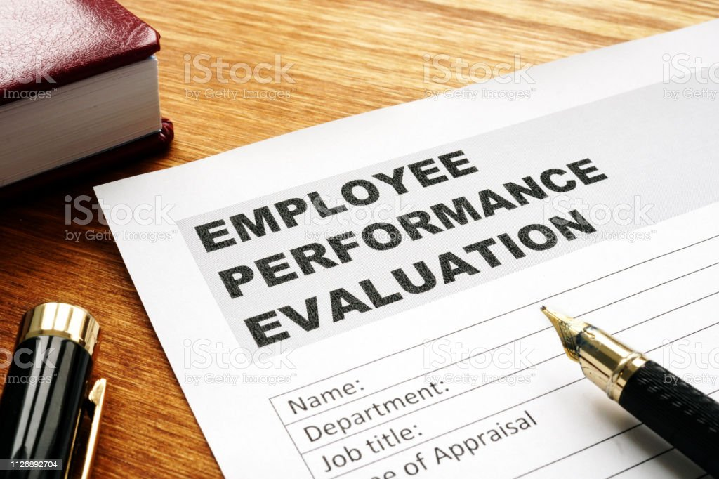 employee performance evaluation form on a desk stock photo