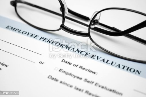 Close up of glasses on employee performance evaluation form