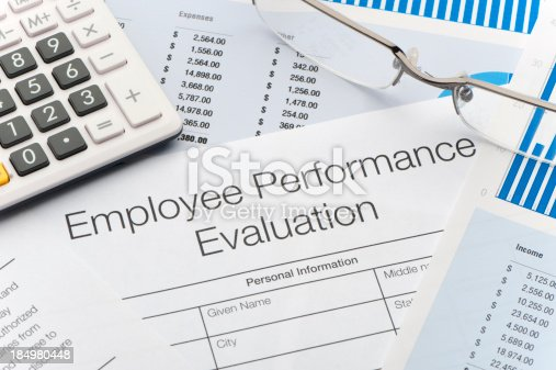 Close up of an Employee Performance Evaluation Form with figures