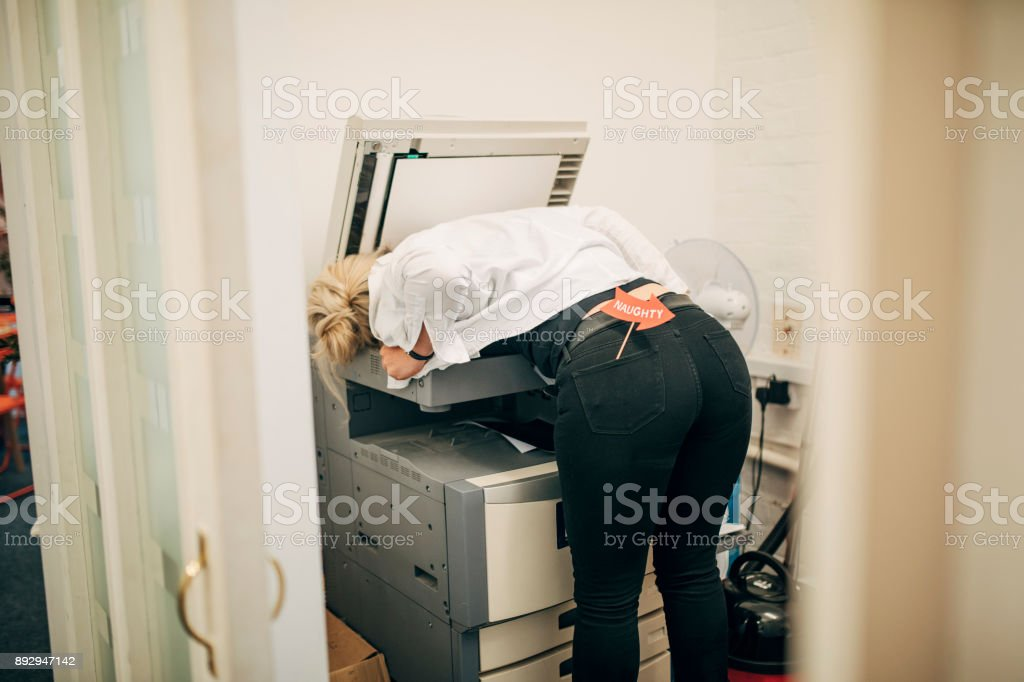 Employee Photocopying Her Chest stock photo