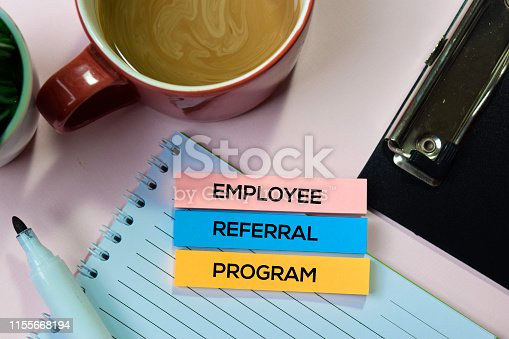istock Employee Referral Program text on sticky notes with office desk concept 1155668194