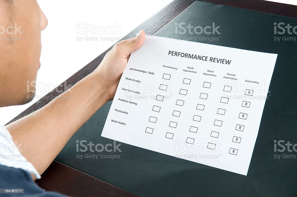 Employee Reviewing Performance Review stock photo