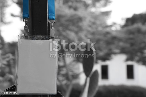 668954740istockphoto Employee tag hanging on a tree 668952356