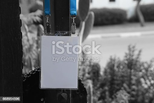 668954740istockphoto Employee tag hanging on a tree 668954596