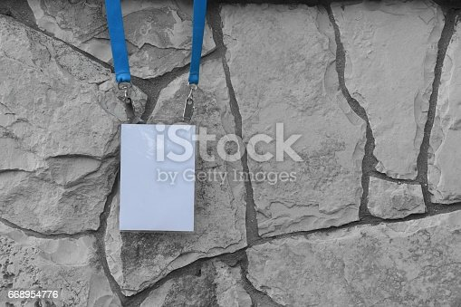 668954740istockphoto Employee tag hanging on a tree 668954776