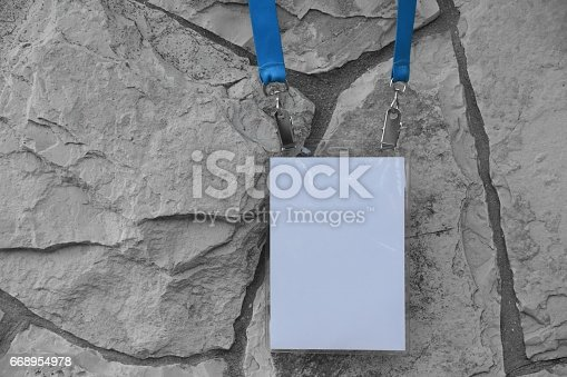 668954740istockphoto Employee tag hanging on a tree 668954978