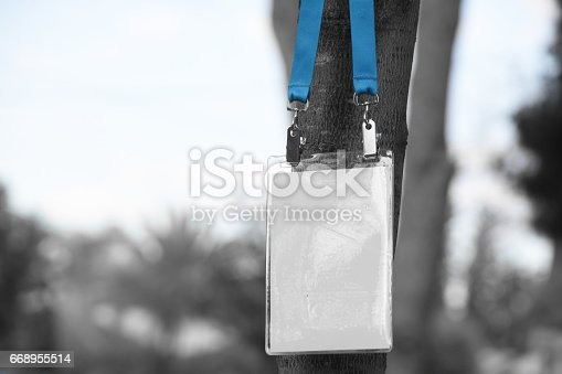 668954740istockphoto Employee tag hanging on a tree 668955514