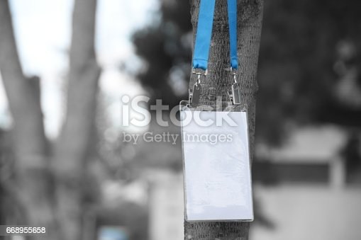 668954740istockphoto Employee tag hanging on a tree 668955658