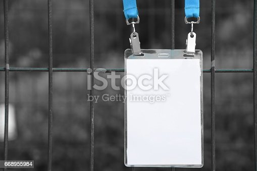 668954740istockphoto Employee tag hangs on a fence 668955984