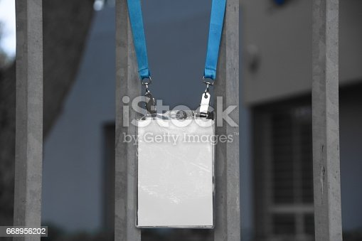 668954740istockphoto Employee tag hangs on a fence 668956202