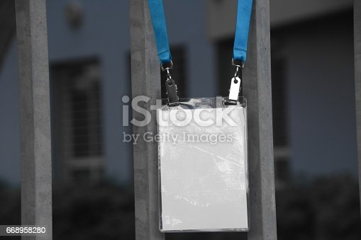 668954740istockphoto Employee tag hangs on a fence 668958280