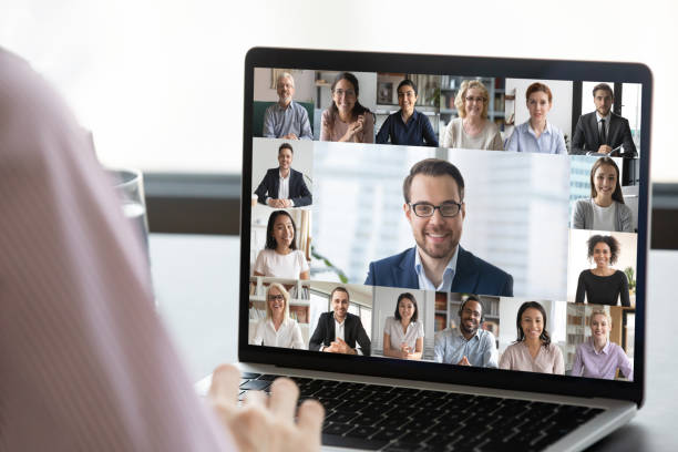 Employee talk on webcam conference with diverse colleagues stock photo