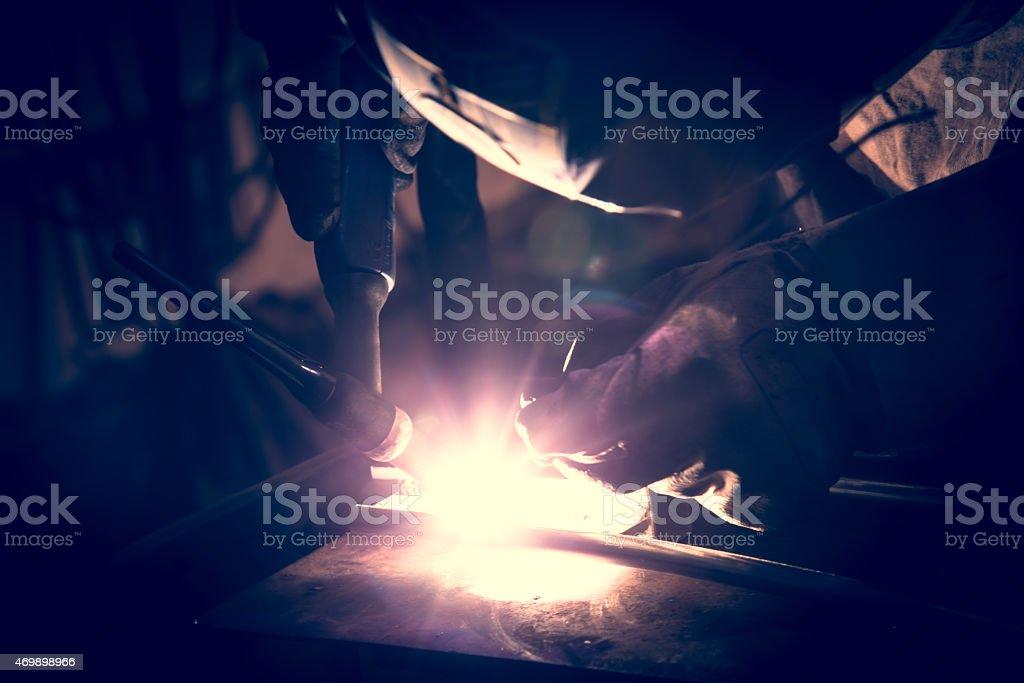 Employee welding aluminum using TIG welder. stock photo