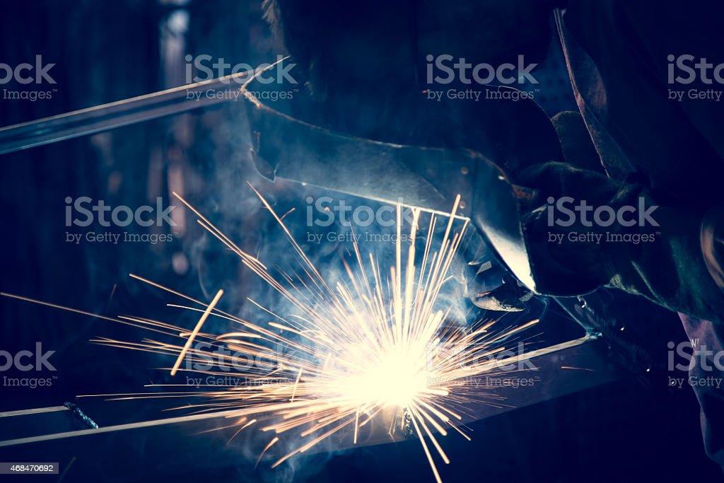 Employee welding steel stock photo