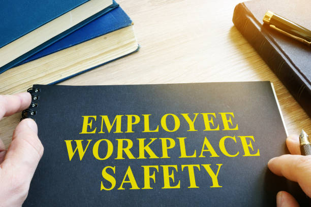 employee workplace safety guide on a table. - safety stock pictures, royalty-free photos & images