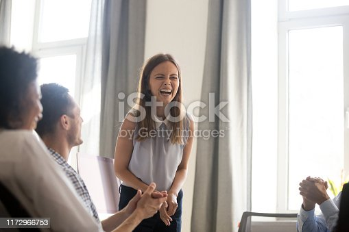 istock Employees applaud greeting excited colleague with job promotion 1172966753