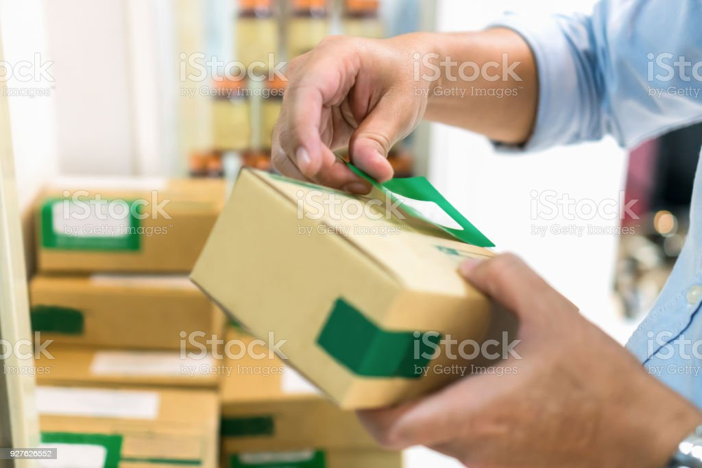 Employees are packing a parcel in the send to the customer. Online ordering For the convenience of customers. stock photo
