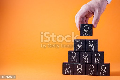 istock Employees are represented by wooden cubes. Business concept for human resources. 871620914