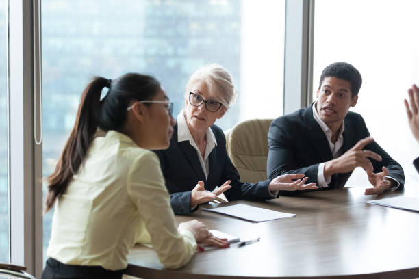 employees dispute accusing colleague during company meeting - conflict stock pictures, royalty-free photos & images