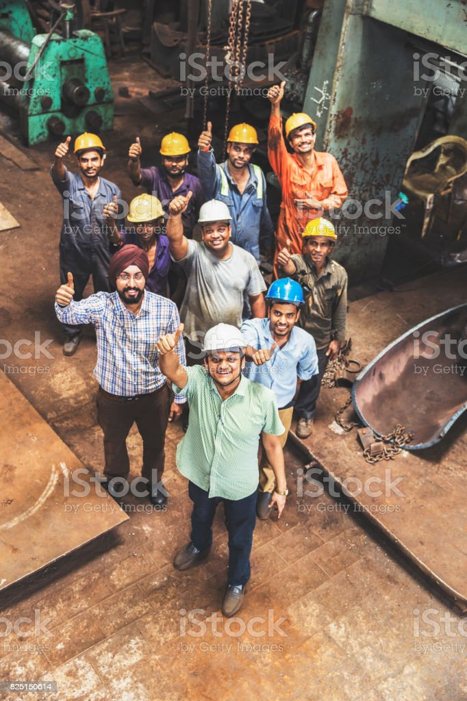 Employees giving a thumbs up towards the camera stock photo