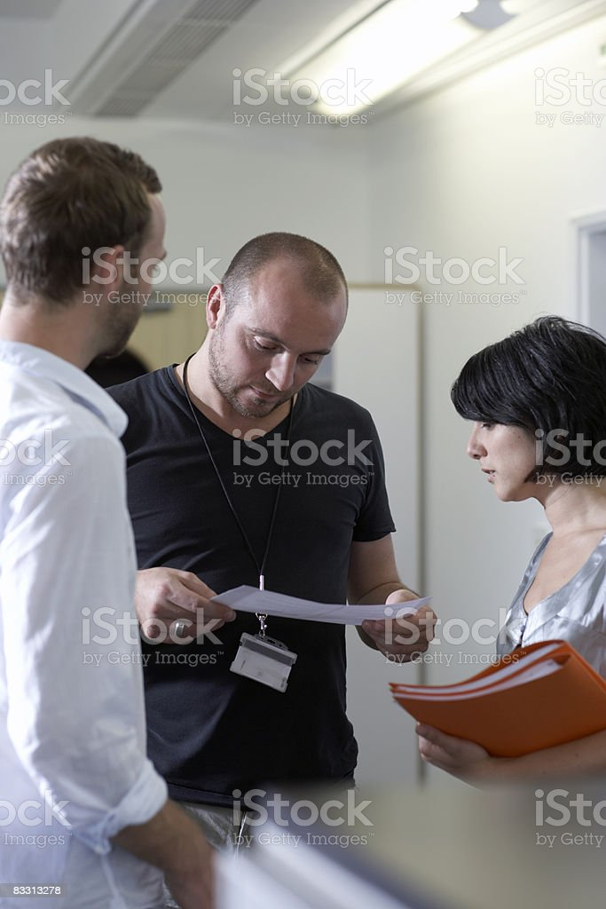 employees meet in corridor royalty-free stock photo
