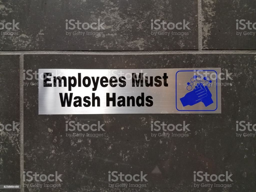 employees must wash hands sign on bathroom wall stock photo