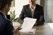 istock Employer conducting job interview, reviewing good resume of successful applicant 804671746
