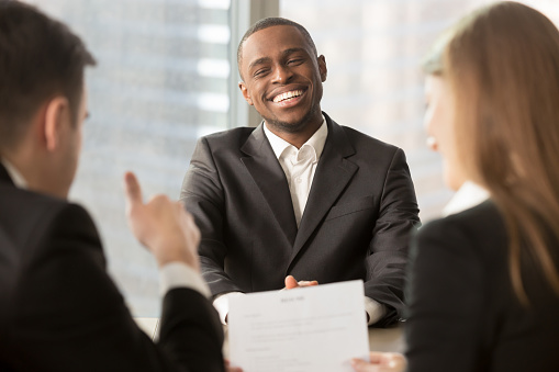 istock Employer showing thumbs up to successful black candidate at interview 695760174