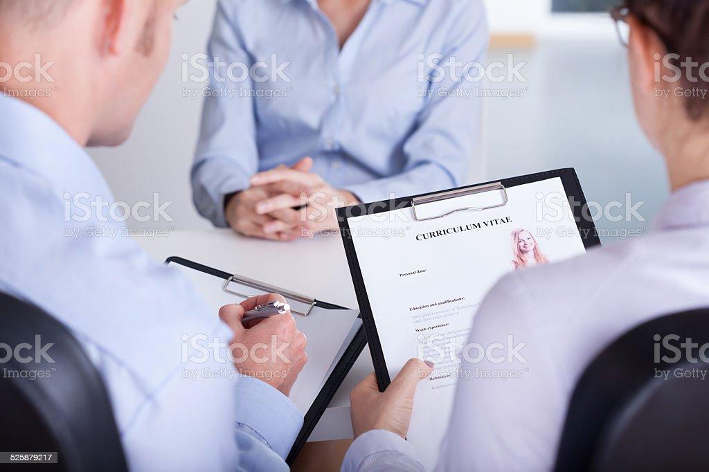 Employers checking curriculum vitae stock photo
