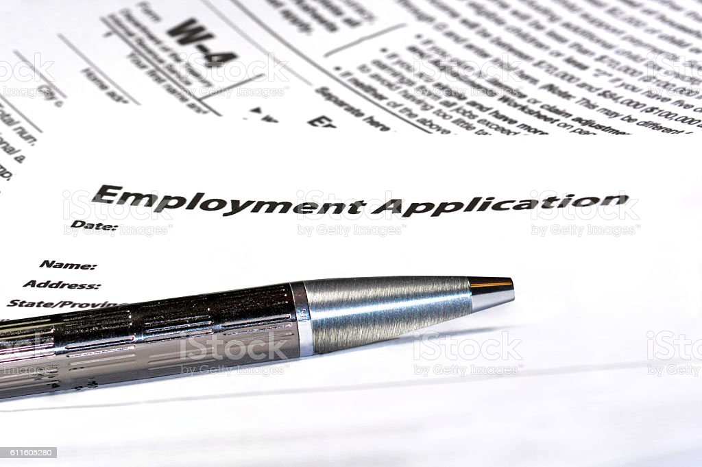 Employment agreement with W-4 form stock photo