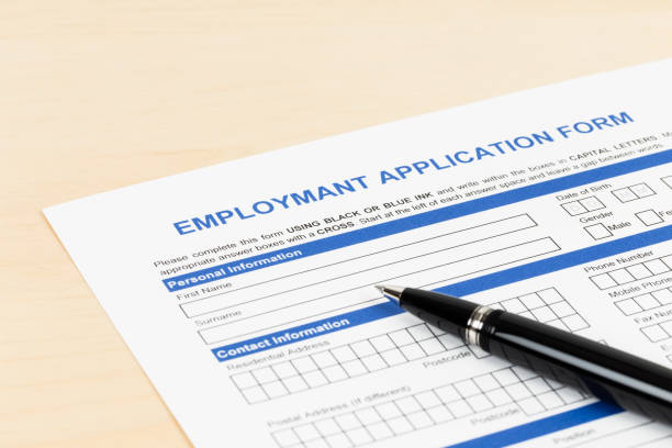 Employment application form with pen concept job applying Employment application form with pen concept job applying application form stock pictures, royalty-free photos & images
