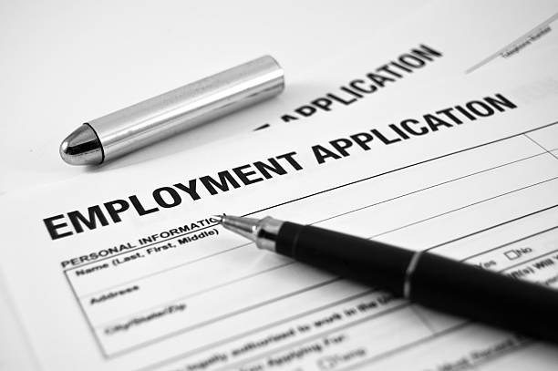 Employment Application An Employment Application ready to be fill. application form stock pictures, royalty-free photos & images