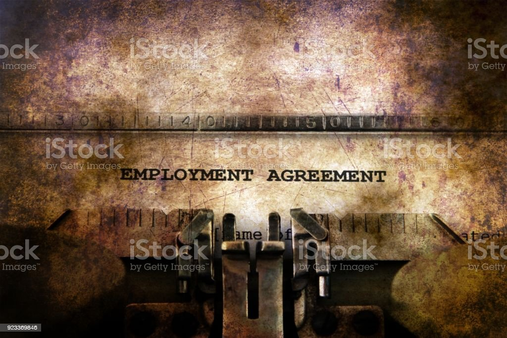 Employment contract on vintage typewriter stock photo