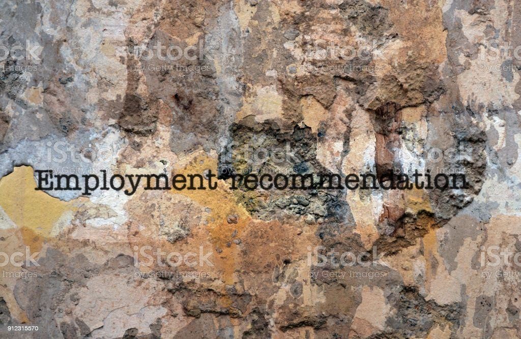 Employment recommendation text on wall stock photo