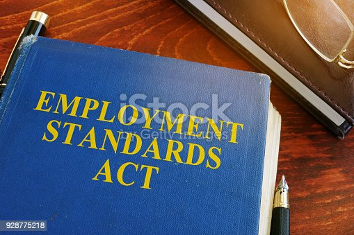 istock Employment standards act and glasses on a desk. 928775218