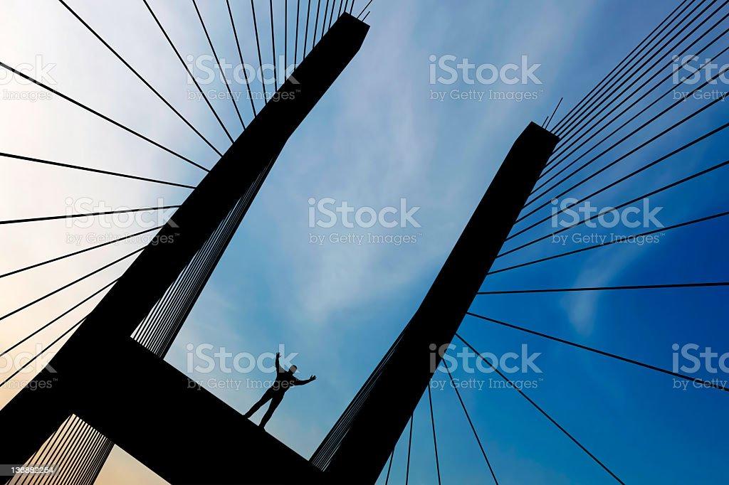 XXL empowered man silhouette stock photo