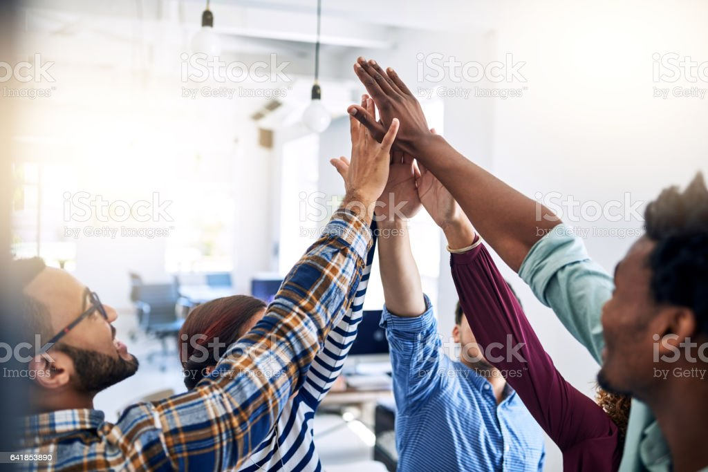 Empowering each other to aim for their best royalty-free stock photo
